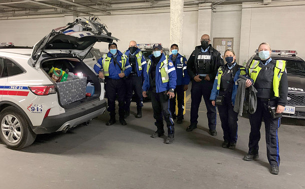 A group of Parking officers beside a parking vehicle