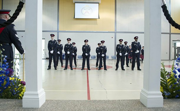 A group of TPS officers in two lines