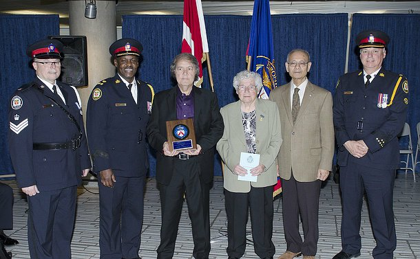 Staff Segeant George Mullin, Deputy Chief Mark Saunders, Crossing Guards Association president Mona Piper, TPSB chair Alok Mkherjee and Supt. William Wardle presented the Crossing Guard of the Year Award to Damianos Mouzakitis.
