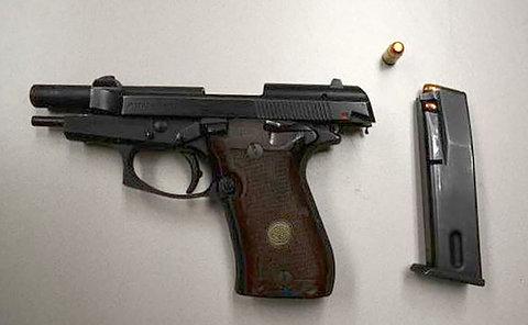 a handgun, bullet  and clip on a table