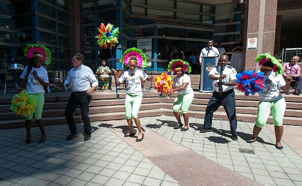 The mayor and Chief with four students dancing