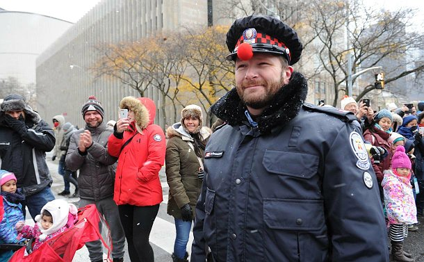 A man in TPS auxiliary uniform with a red nose on his hat