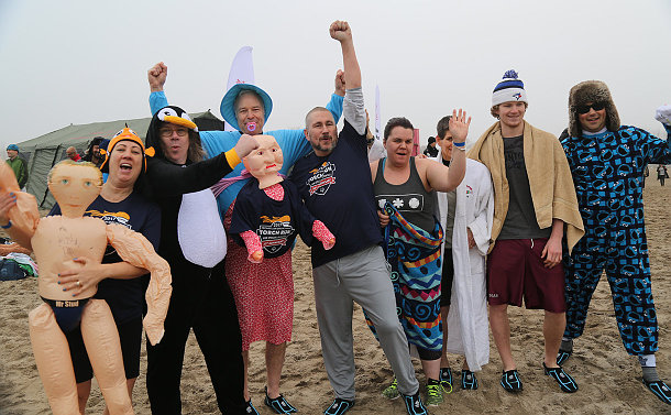 A group of people in costumes on a beach