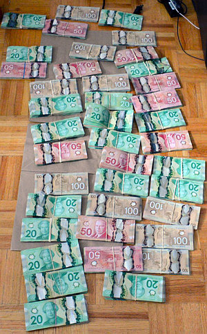 Bundles of Canadian Dollar notes in 20, 50 and 100 denomination