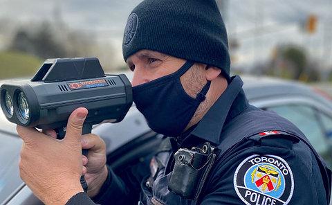 A man in TPS uniform hodling a radar gun