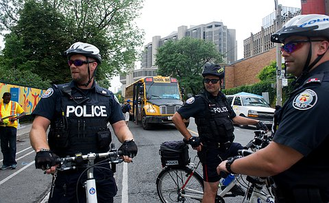 Three officers in TPS uniforms on bicycles