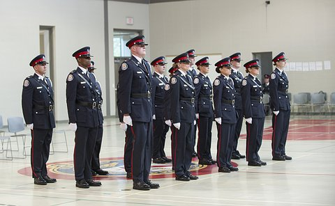 Men and women in TPS uniform standing