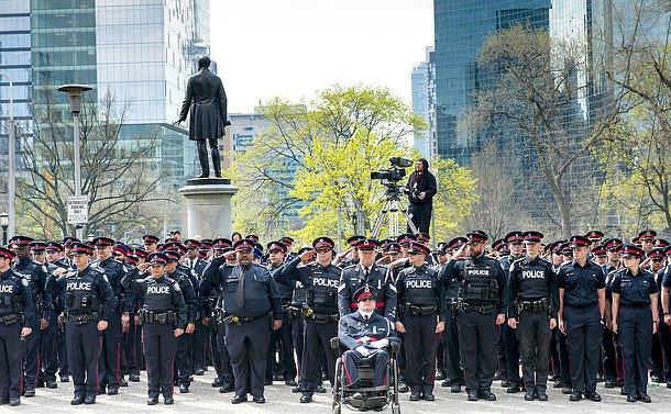 Members in uniform saluting