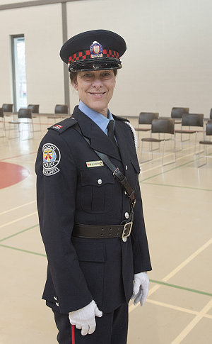 A woman in TPS auxiliary uniform