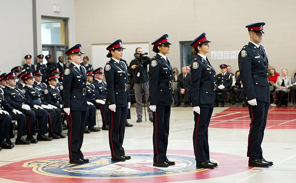 Four women and one man in TPS uniform in a line