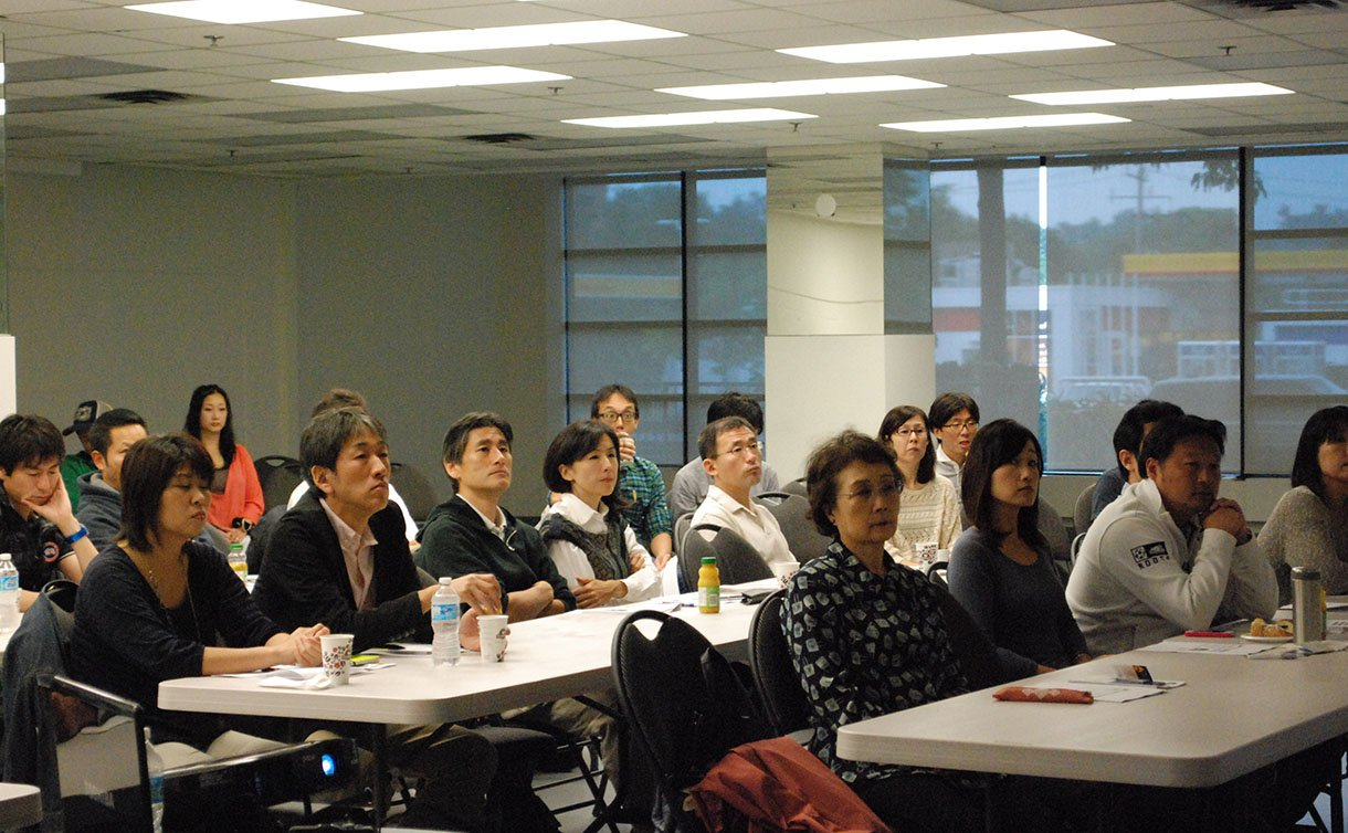 Photo of a classroom environment with Japanese newcomers attending a lecture