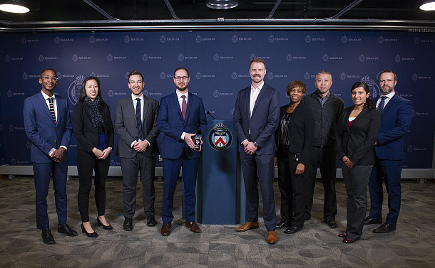 A group of people standing at a TPS podium