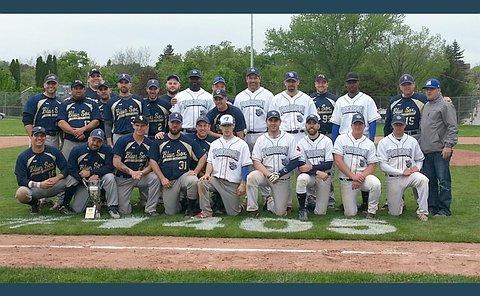A group of two teams in baseball uniforms on a baseball diamond