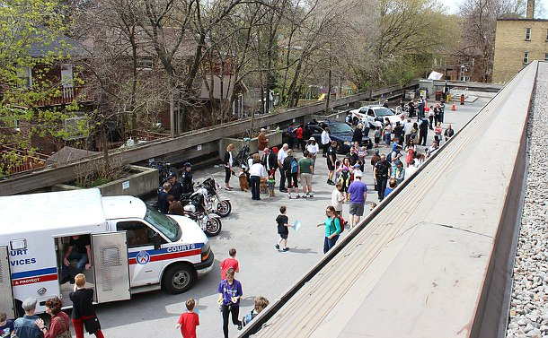 View from roof of activity of event people milling around vehicles and tables