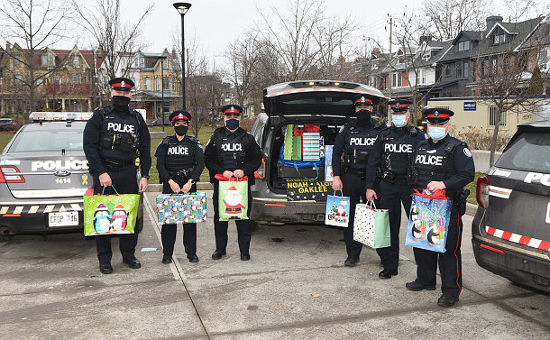 A group of officers holding gift bags