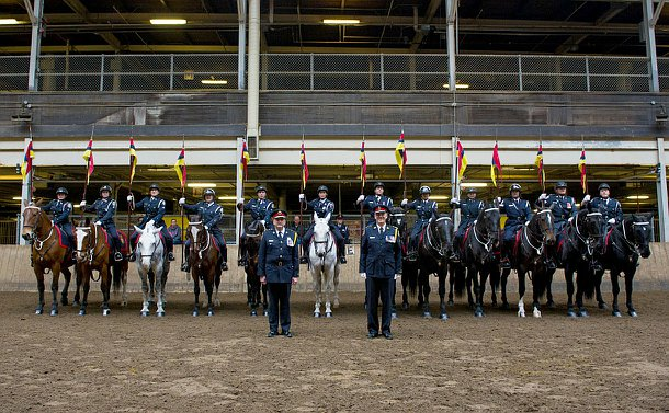 12 officers on horses, with two chief's of police standing in front.
