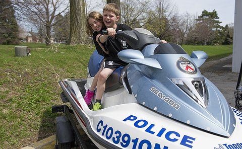 A girl and boy sit on a Seadoo