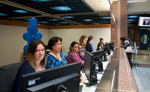 A group of women working on computers at a counter