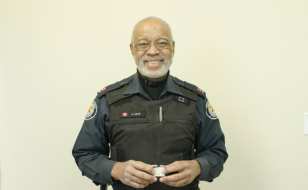A man in TPS uniform holding a jewellery box