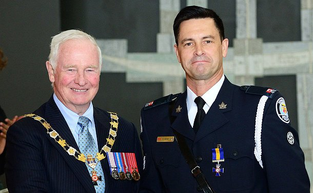 Two men standing together, one wearing chains of office and another wearing a TPS uniform