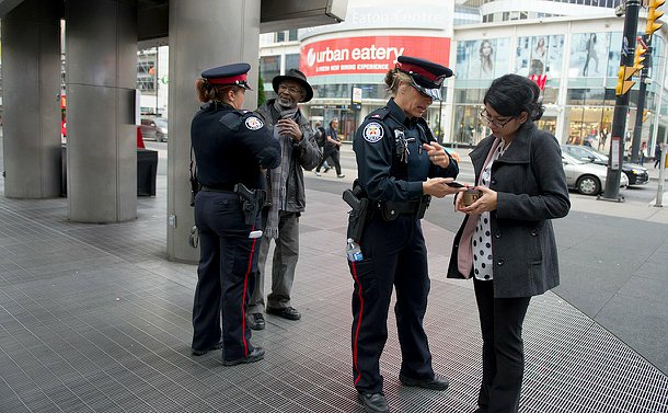 two officers speaking to two different people.