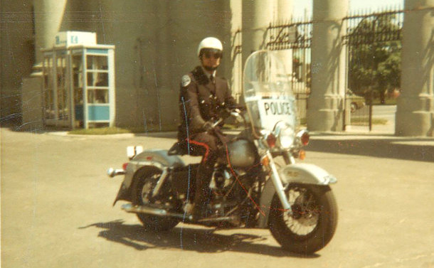A man in uniform on a motorcycle