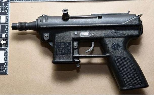 A black gun on a table