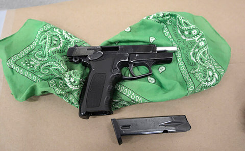 A handgun in a bandana