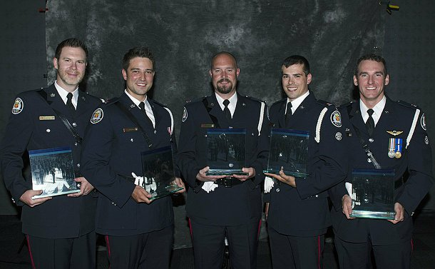 Officers of the Year winners posing with their awards