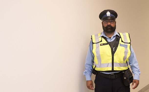 A man in parking uniform