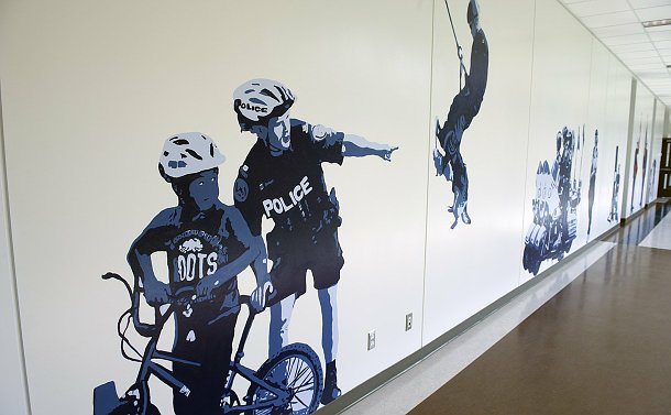 Murals of police officers in a hallway