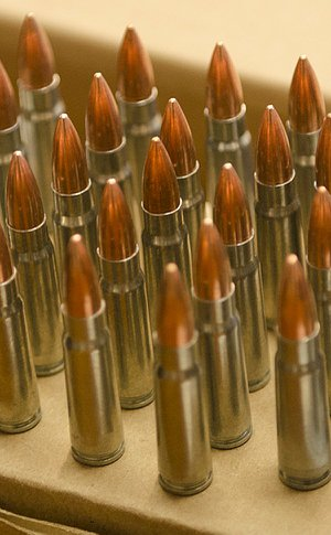 Copper and silver bullets standing on a package