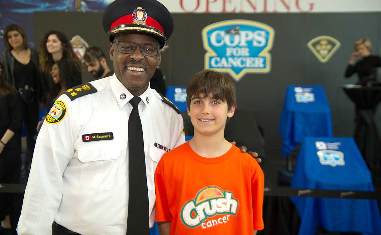 A man in TPS uniform with a boy