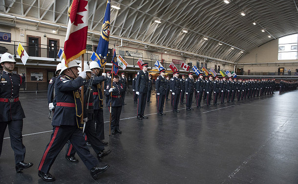 A group of people in TPS uniform lined up