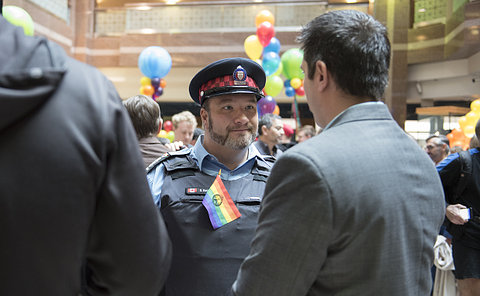A man in TPS auxiliary uniform listening to another man