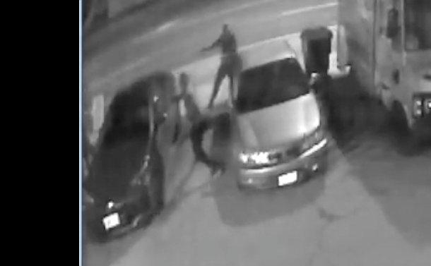 Two men beside a car in a parking lot
