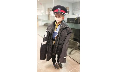 A boy in a TPS hat and jacket