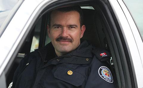 A man in TPS uniform in a car