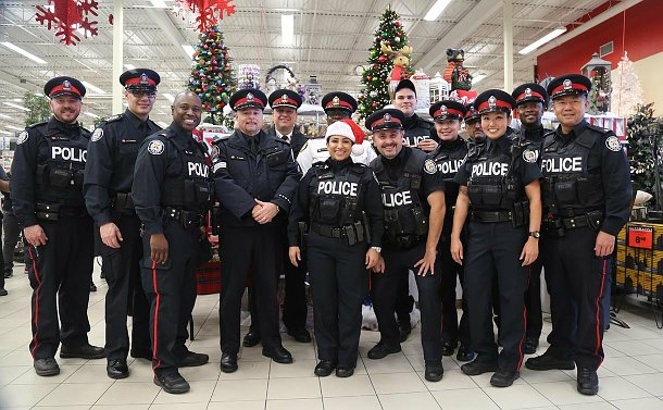 A group of men and women in TPS uniform