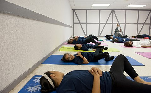 A group of girls laying on mats