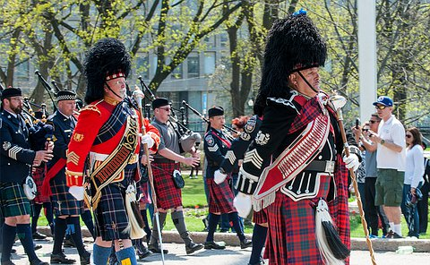 men in pipe band uniforms