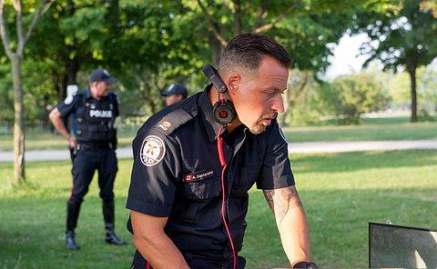 An officer Djing