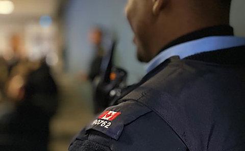 A close up of a man in TPS uniform
