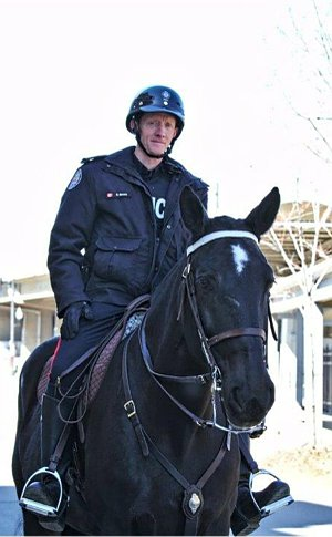 A man in TPS uniform on a horse