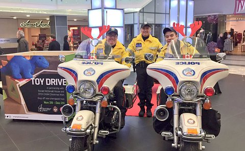 Three men in TPS uniform, two on motorcycles