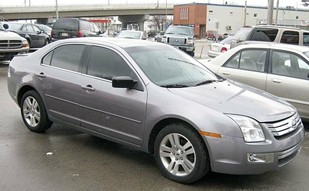A 2006 Ford Fusion, silver, 4 door
