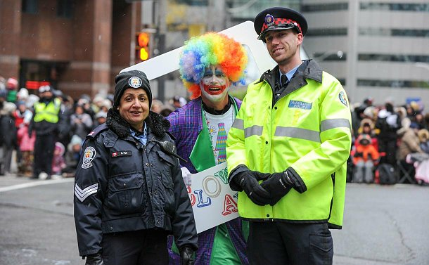 A man and woman in TPS auxiliary uniform with a clown