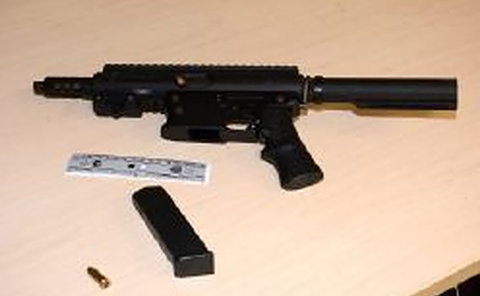A black gun on a table