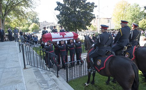 Officers on horses as TPS officers bring coffin