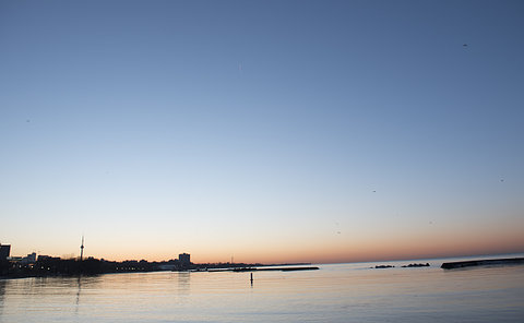 City skyline by lake